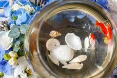 Golden fish decoration. Flower arrangement Royalty Free Stock Image