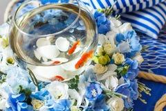 Golden fish decoration. Flower arrangement Stock Image