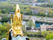 Golden fish sculpture at Osaka castle, Osaka Japan 4. Golden fish sculpture at the roof top of Osaka castle, Osaka, Japan Royalty Free Stock Photo