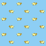 Golden fish seamless pattern. In blue background Vector Illustration