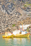 Golden fishing boats in the Caldera, Greece. Stock Image