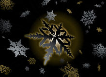 Golden flake. Golden snowflake design with gold and silver flake falling over a dark nights sky Stock Photos