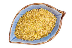 Golden flax meal in a bowl Stock Photo