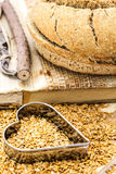 Golden flax seeds with bread and heart Royalty Free Stock Image