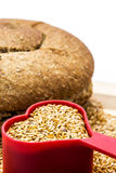 Golden flax seeds with bread and heart Royalty Free Stock Photo