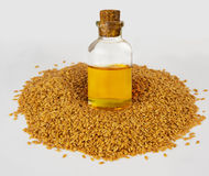 Golden flax seeds and flaxseed oil. Super food. Royalty Free Stock Photo