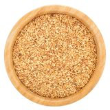 Golden flax seeds in wooden bowl isolated. Royalty Free Stock Photo