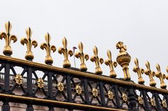 Golden fleur de Lis on the gates of Buckingham Palace, London, UK. Golden fleur de Lis on the gates of Buckingham Palace, London, United Kingdom Royalty Free Stock Image