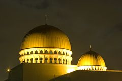 Golden Floating Mosque at Night Royalty Free Stock Photos