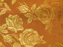 Golden floral fabric texture Royalty Free Stock Photography