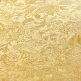Golden floral ornament brocade textile pattern Royalty Free Stock Photos