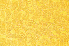 Golden floral ornament brocade textile pattern Royalty Free Stock Images