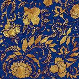 Golden floral  pattern on blue  backgraund Stock Image