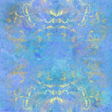 Golden floral pattern on blue background Stock Image