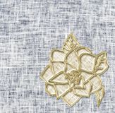 Golden flower on denim background. Idea for greeting card Stock Photos
