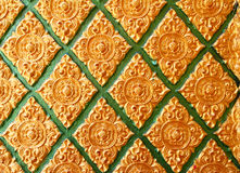 Golden flower of Thai stucco art. Royalty Free Stock Image