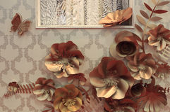 Golden flower on the wall decoration Royalty Free Stock Photos
