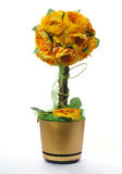 Golden flowerpot with artificial flowers Stock Image