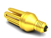 Golden fluorescent energy saving light bulb Royalty Free Stock Image