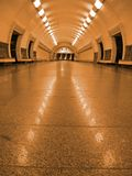 Golden fluorescent subway tunnel lighting, nobody Stock Image