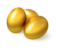 Golden fluted eggs. Stock Images