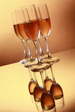 Golden flutes of cold wine Stock Photography