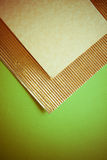 Golden flutted paper on green Royalty Free Stock Photos