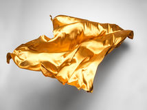Golden flying fabric Royalty Free Stock Photography