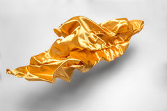 Golden flying fabric Royalty Free Stock Image