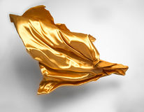 Golden flying fabric Stock Photography
