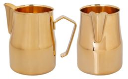 Golden Foaming Jug. Stainless Steel Milk Pitcher/Jugs. royalty free stock photo