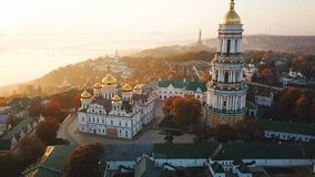 Golden foggy morning in Kiev Ukraine. Kiev Pechersk Lavra. Aerial drone video footage. stock footage
