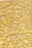 Golden foil. Detailed image of golden colored foil royalty free stock photography