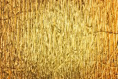 Golden foil abstract textured background. Stock Photo