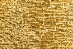 Golden foil abstract textured background. Royalty Free Stock Images