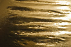 Golden foil background. With highlights and shadows Stock Photos