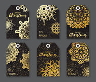 Golden Foil Christmas labels. Festive collection of black background. Stock Images