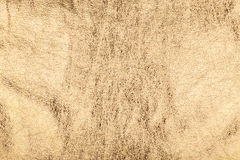 Golden foil grunge background. With space for text or image Royalty Free Stock Photography