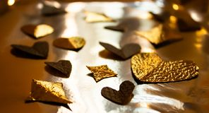 Golden foil heart shaped decorations for valentines stock images