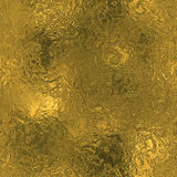 Golden Foil Seamless And Tileable Luxury Background Texture. Glittering Holiday Wrinkled Gold Background. Stock Photography