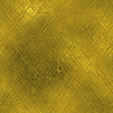 Golden Foil Seamless and Tileable luxury background texture. Glittering holiday wrinkled gold background. Royalty Free Stock Photography