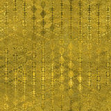 Golden Foil Seamless and Tileable luxury background texture. Glittering holiday wrinkled gold background. Stock Photo