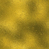 Golden Foil Seamless and Tileable luxury background texture. Glittering holiday wrinkled gold background. Stock Photos