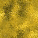 Golden Foil Seamless and Tileable luxury background texture. Glittering holiday wrinkled gold background. Royalty Free Stock Image
