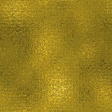 Golden Foil Seamless and Tileable luxury background texture. Glittering holiday wrinkled gold background. Royalty Free Stock Photos