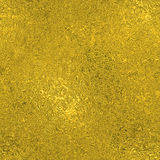 Golden Foil Seamless and Tileable luxury background texture. Glittering holiday wrinkled gold background. Royalty Free Stock Photo