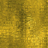 Golden Foil Seamless and Tileable luxury background texture. Glittering holiday wrinkled gold background. Stock Images