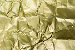 Golden foil textured and background Stock Photos