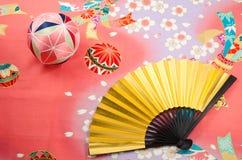 Golden folding fan and handball Royalty Free Stock Image