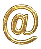 Golden font. 'At' sign. Gold symbol as bars. Letter as grainy bar of gold Royalty Free Stock Photography